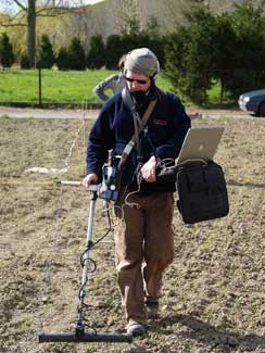 Malcolm Weale of Geofizz Ltd. carrying out a ground penetrating radar survey of the Givenchy site